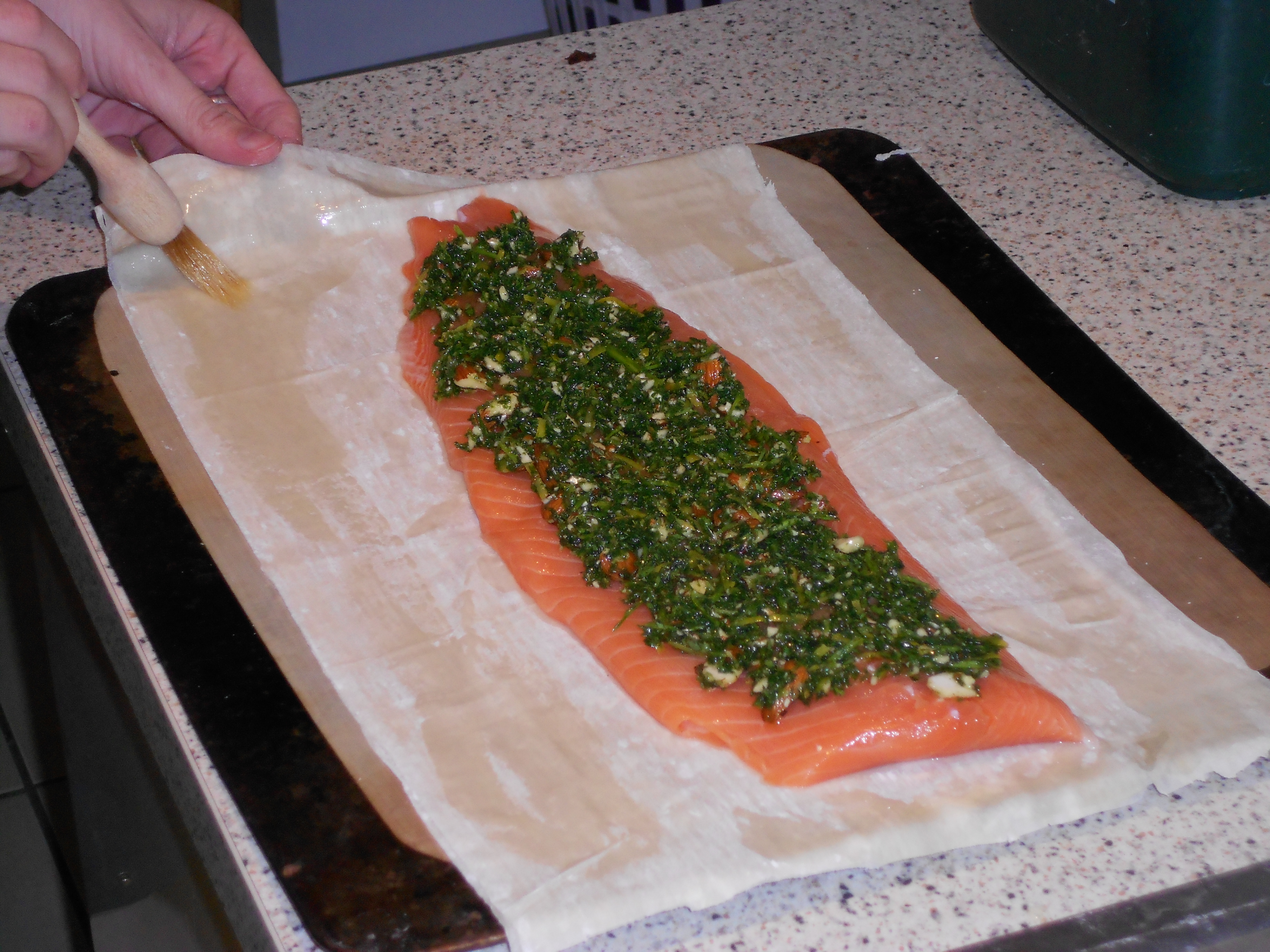 2 On A Large Baking Tray Arrange A Couple Of Filo Sheets To Cover The Base  Of Your Salmon Now Put The Skinned Salmon Along The Centre Of The Pastry  And Top